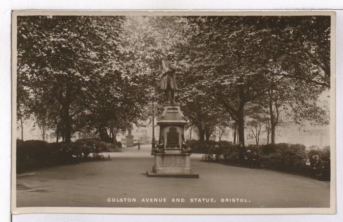 An archival image of the bronze Edward Colston statue in Bristol, situated on Colston Avenue in an open plaza.